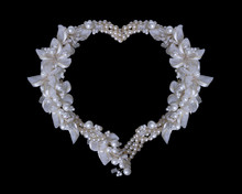 Frame Of Pearls And Flowers On...