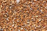 Fototapeta Kamienie - Close up of wet shingle on a beach