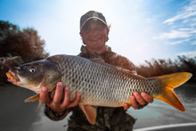 Happy Fisherman Holds The Big ...