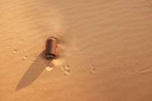 A Rusty Empty Can On Desert S...