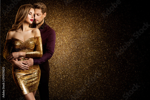 Fototapeta Couple Beauty Portrait, Dreaming Beautiful Woman in Gold dress embracing Elegant Man, Love concept obraz