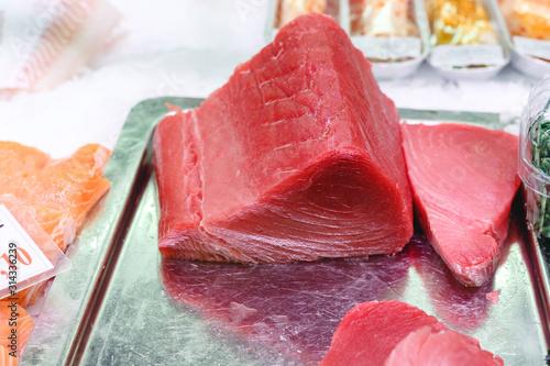 Raw Tuna Fish fillet for sashimi or steak at the fish market Canvas Print