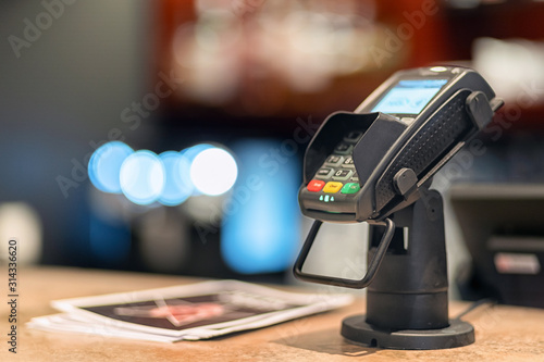 Bank terminal and payment card on the office table Canvas Print