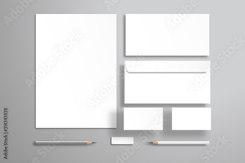 White sheet of paper or blank, two envelopes, two business cards, pencils and an eraser Wallpaper Mural