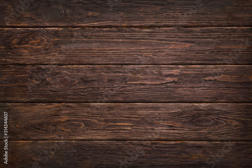 Obraz Wooden dark brown retro shabby planks wall ,table or floor texture banner background.Wood desk photo mockup wallpaper design for decoration . - fototapety do salonu