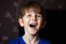 Portrait Of A Laughing Boy On ...