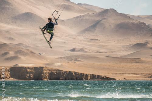 Obraz KiteSurfing in the amazing desert and ocean of Peru. - fototapety do salonu