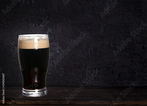 Glass of beer on wood dark background with copyspace for text Canvas-taulu
