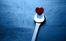 Wrench And Red Heart On A Text...