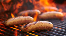 Tasty Bratwurst Sausage Barbecuing On The Grill