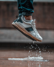 Jumping On A Puddle In The Rain