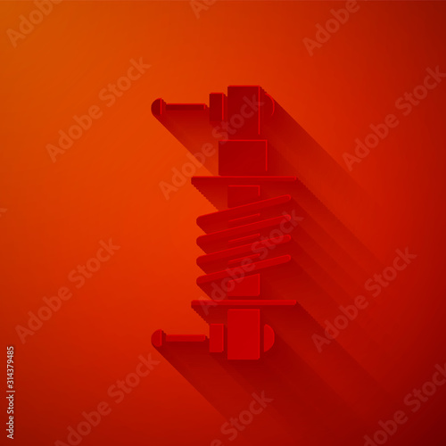 Photo Paper cut Shock absorber icon isolated on red background