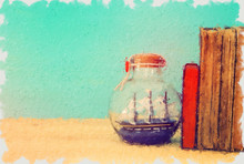 Oil Painting Style Illustration Of Sail Boat In The Bottle Next To Books Over Wooden Table