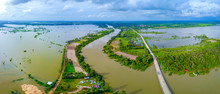 Panorama Top View Aerial Photo From Flying Drone.Flooded Rice Paddies And Village.Flooding The Fields With Water In Which Rice Sown. View From Above,Moon River,Sisaket Province,Thailand,ASIA.