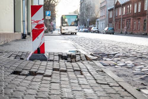 Damaged pedestrian sidewalk Fototapeta