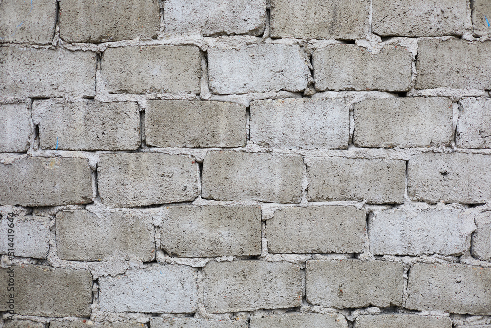 Wall of concrete blocks. Clear cement mortar. Texture, background.