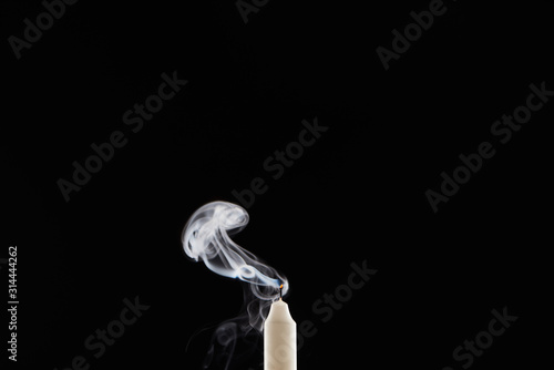 Fotografie, Tablou extinct white candle with smoke on black background