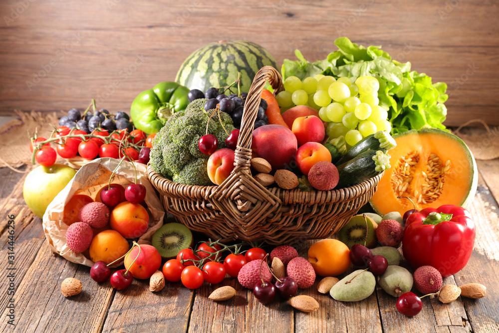 Fototapeta assorted of fruit and vegetable in wicker basket
