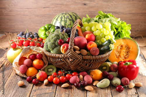 assorted of fruit and vegetable in wicker basket - 314446236