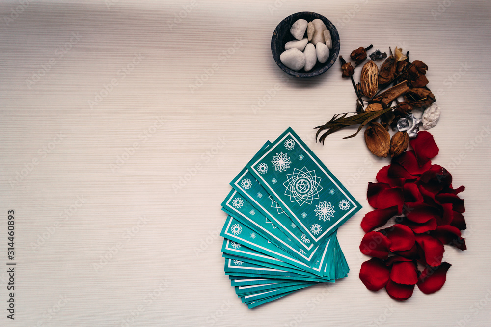Fototapeta Green tarot cards with different mystical objects. Space for texts