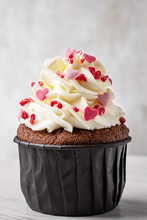 Chocolate Cupcake With Vanilla Frosting And Little Pink Hearts On The Top. Valentines Day Concept