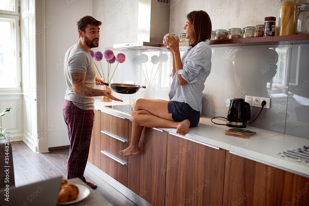 Fototapeta happy couple in morning celebratin valentines day in kitchen. sexy and in love - obraz na płótnie