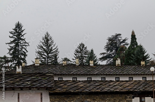 Fragment of the stone roof of the ancient Troyan Monastery founded in 1600 and r Fototapet