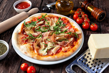 Delicious Pizza On The Rustic Wooden Table