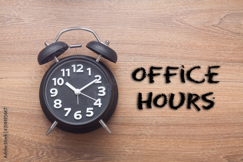 Fototapeta Office hours -  Business handwriting with clock