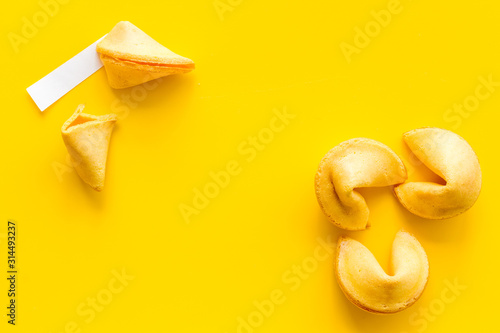 Traditional fortune cookies on yellow table top-down copy space Tableau sur Toile