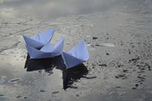 Paper Boats Sail On Frozen Wa...