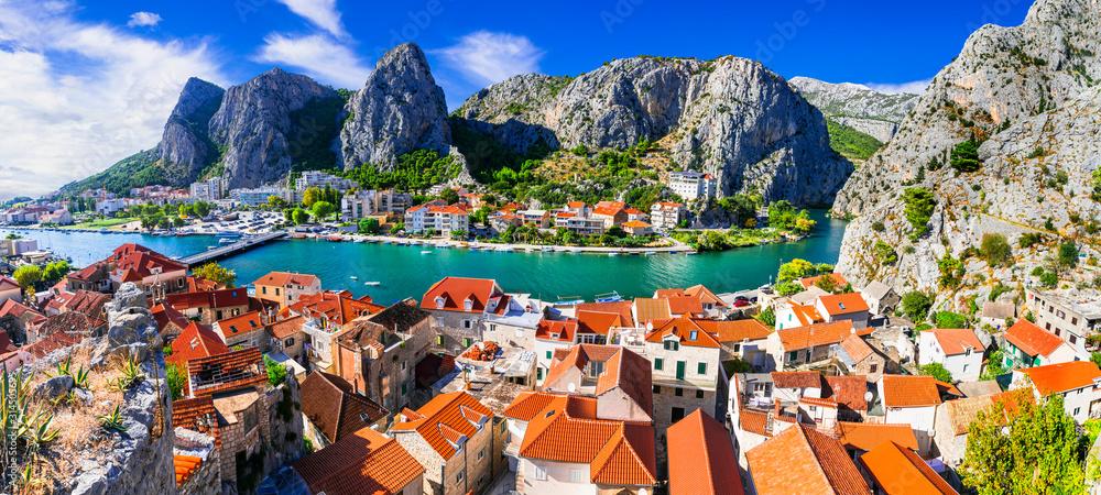 Fototapeta Landmarks of Croatia - impressive Omis town popular tourist destination for trekking and rafting over Cetina river