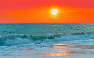 Fototapeta Wschód / zachód słońca Beautiful sunset in front of the sea- orange sun