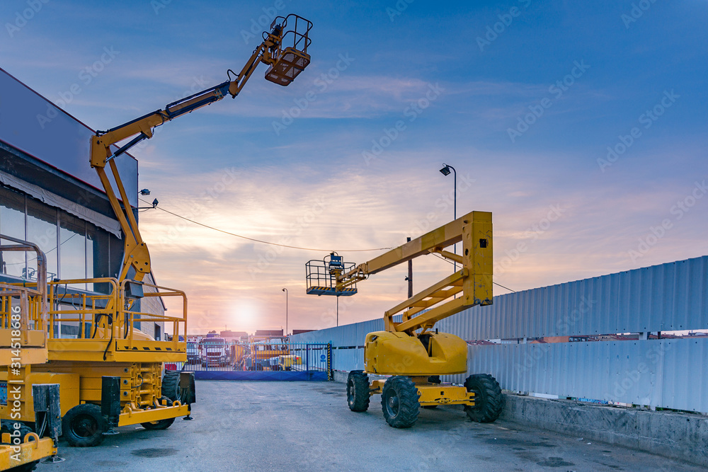 Fototapeta Lifting platforms for construction, useful machinery for the construction sector