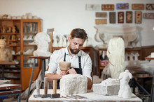 Bearded Craftsman Works In Whi...