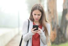 Worried Girl Checking Phone Wa...