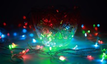Colored Lights Shine With Bright Rainbow Colors In A Vase