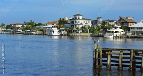 Fototapeta Waterfront homes facing Matanzas Bay in downtown Fort Myers Beach, Florida, USA