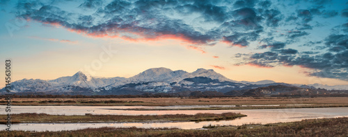 Canvas Print Eic landscape image of Snowdonia snowcapped mountains with dramatic sunset cloud
