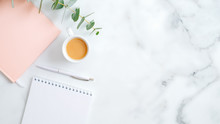 Wedding Planner, Cup Of Coffee, Pink Notebook, Pen, Eucalyptus Leaf On Marble Desk. Flat Lay, Top View, Copy Space. Wedding, Bridal, Marriage Concept.