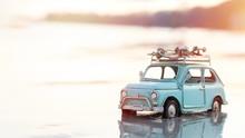 Miniature  Tin Car  Closeup At Summer Beach Scene