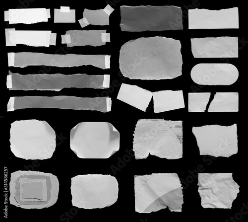 Fotomural Set of torn paper texture on black background, copy space.
