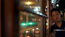 Asian Man On Hong Kong Tram Af...
