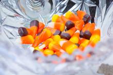 A Closeup Of A Glass Dish Of Candy Corn.