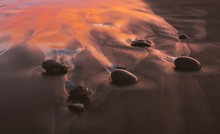 Closeup Of Stones On A Beach W...