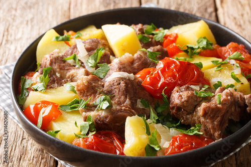 Obraz na plátně  Tasty Khashlama from lamb meat with vegetables close-up in a bowl