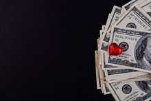 Dollar Bills On A Black Background And A Red Heart
