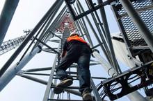 Technician Working On High Tel...