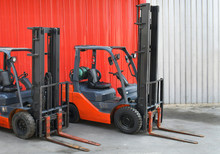 Parked Forklifts In Warehouse...