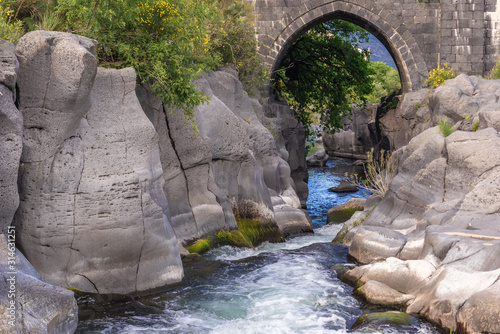 Old stone bridge over River Alcantara near Castiglione di Sicilia village, Sicil Canvas Print